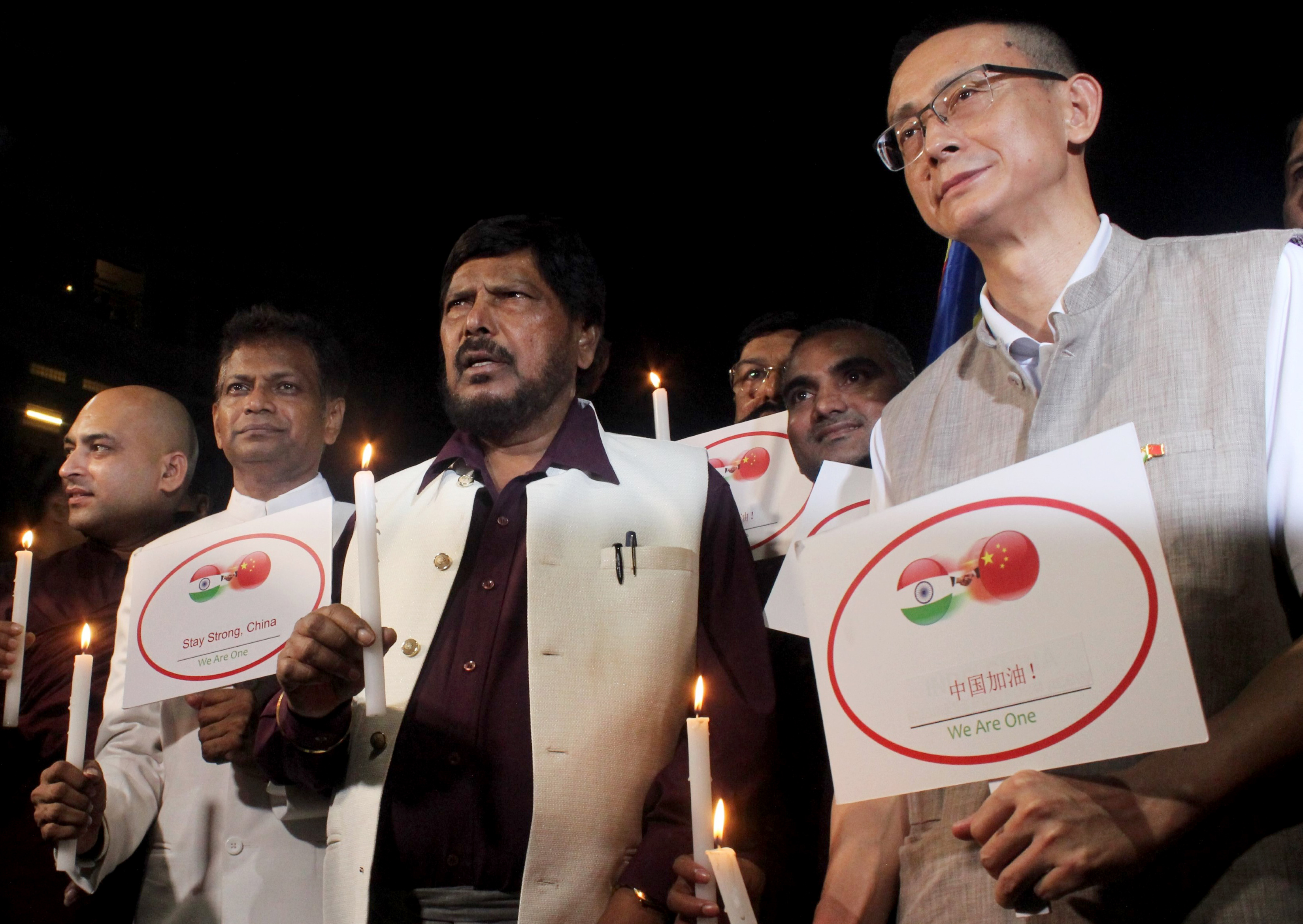Union Minister of State for Social Justice and Empowerment Dr. Ramdas Thawale along with Chinese counsel General Tang Goucai take out a candle march